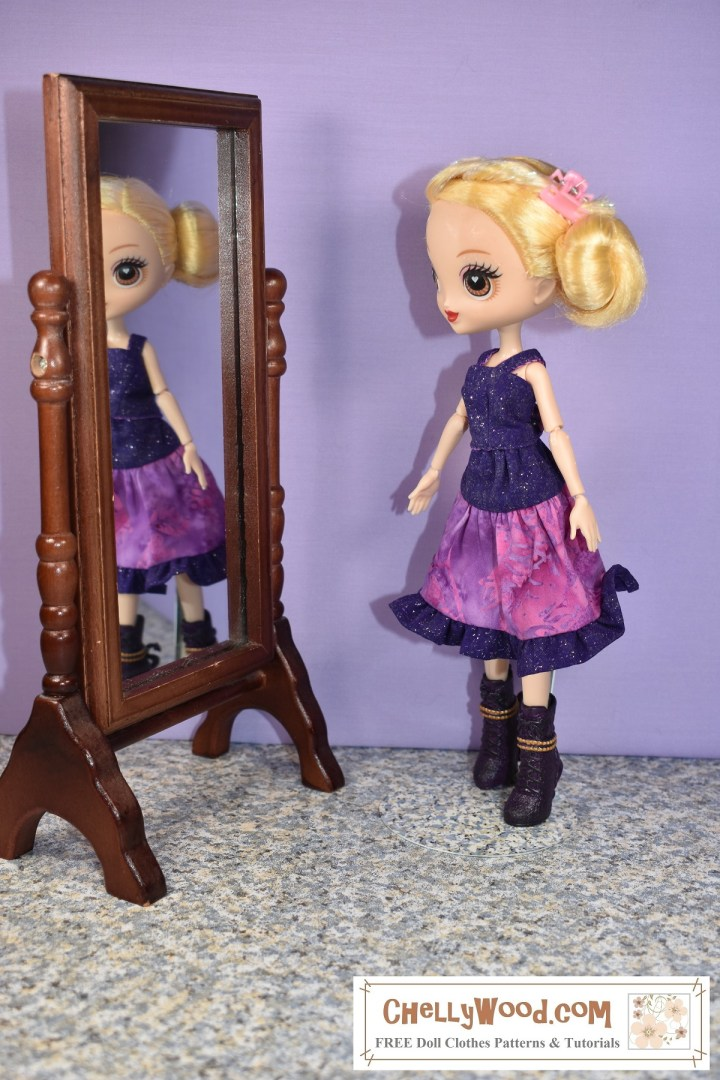 If you'd like to sew this 3-tier skirt and tank top with straps for your 10 inch (25 to 26 cm) dolls, please click on the link in the caption. Here we see a 10 inch (25 to 26 cm) Kuu Kuu Harajuku G doll wearing a purple handmade tank top with a pink and purple 3-tier skirt with a ruffle. The doll stands in front of a mirror, and in the mirror, we see the doll's blurred reflection, as though she's looking at her reflection in that mirror.