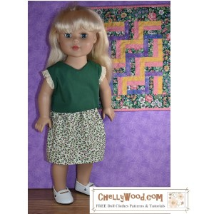 """The image shows a Madame Alexander 18 inch doll (45-46 cm tall) wearing handmade holiday clothes. Her outfit includes a V-neck shirt in holiday green with creamy eyelet lace sleeves and a white skirt decorated with tiny holly leaf and holly berry print fabric. The doll wears patent leather Mary Jane shoes, and she stands before a purple wall on which hangs a miniature quilt with a zig-zag pattern of fabrics in greens, purples, pinks, and yellows. The watermark on the image says """"ChellyWood.com: free doll clothes patterns and tutorials."""" If you would like to make this outfit for your 18 inch doll, please visit ChellyWood.com and navigate to the page for 18 inch doll clothes patterns and tutorials. This outfit will fit most 18-inch dolls such as the Adora Amazing Girls dolls, the Our Generation Journey Girls, the """"My Life As"""" Dolls, 18-inch Dolls from American Girl doll company, City Girls from the New York Doll Collection, and as shown, the Madame Alexander 45 to 46 cm dolls."""