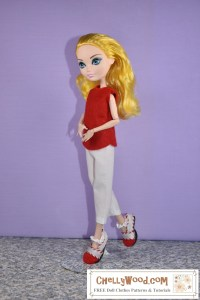 This is an image of an Ever After High doll wearing handmade doll clothes including a red felt sleeveless shirt, a pair of white ankle pants with an elastic waist, and a pair of Mary Jane style shoes in red and white. If you'd like the free printable PDF sewing patterns for making these doll clothes which will fit Monster High and Ever After High dolls (among others), please click on the link in the caption.