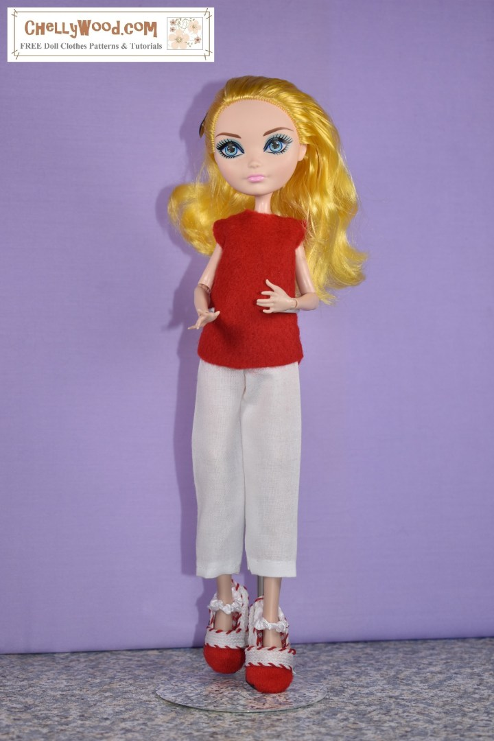 This is an image of an Ever After High doll wearing handmade doll clothes including a red felt sleeveless shirt, a pair of white ankle pants with an elastic waist, and a pair of Mary Jane style shoes in red and white. For the free printable PDF sewing patterns and tutorial videos showing how to make these doll clothes for your Monster High or Ever After High dolls, please go to ChellyWood.com and click on the 10 inch or 11 inch doll clothes patterns link in the main gallery at the home page.