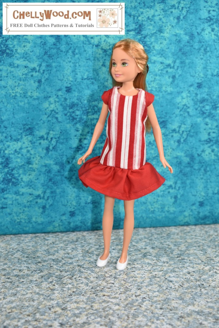 This photo shows Mattel's 9 inch Stacie doll wearing a handmade dress, designed and sewn by Chelly Wood, the doll clothing designer, YouTuber, and writer. The dress itself looks a lot like a peppermint candy, with red and white stripes running vertically. There's a solid red skirt at the bottom of the dress, and this skirt forms a ruffle that goes from the dress's dropped waist to just above Stacie's knee. There are also solid red cap sleeves. The doll wears tiny plastic white flat shoes. Her hair is drawn back in a barrette. She looks to her right slightly, and the background is a splotchy turquoise blue which contrasts nicely with the red and white of the handmade dress. For the free printable sewing patterns and tutorial videos to make this dress, please go to ChellyWood.com