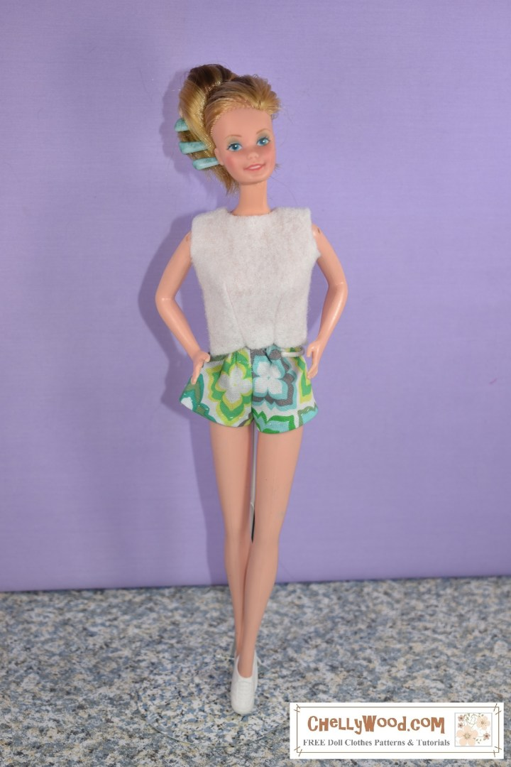 "This image shows a SuperStar Barbie from the early 1980's modeling a pair of short-shorts in geometric-design-patterned fabric and a felt sleeveless ""sweater,"" both of which were handmade using Chelly Wood's free printable sewing patterns. If you'd like to learn more about Chelly Wood's free PDF sewing patterns, visit ChellyWood.com"