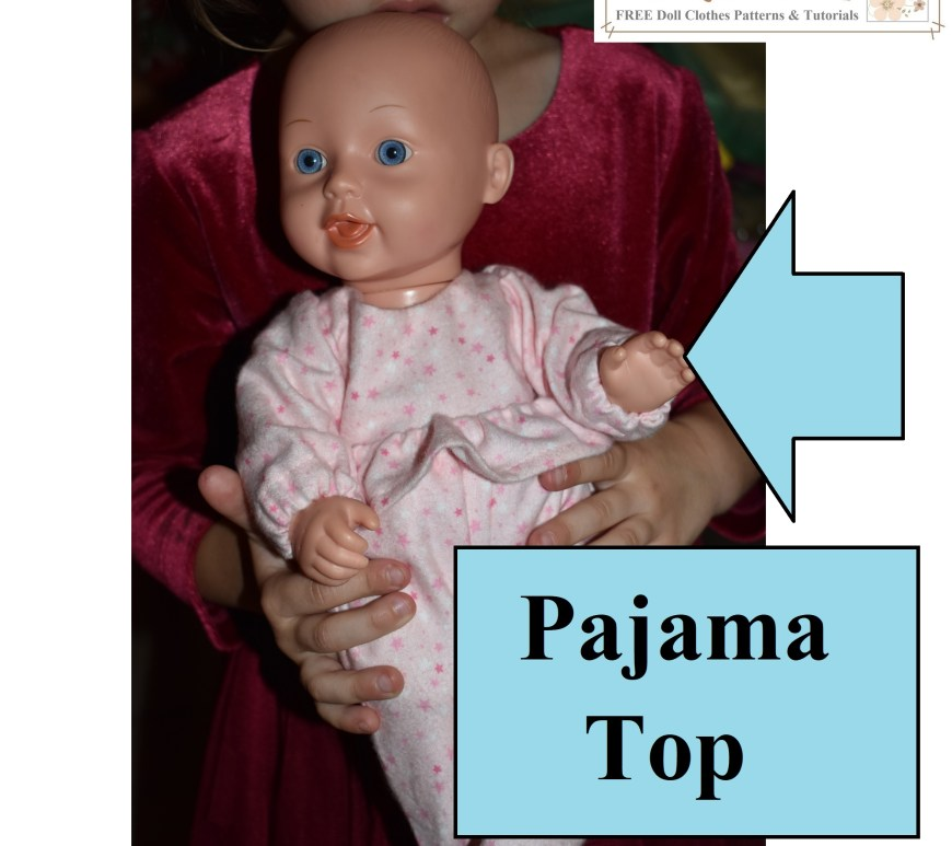 The image shows Chelly Wood's niece holding her baby doll as she displays the footie pajamas her Aunt Chelly made for her baby doll. The image includes an arrow pointing at the pajama top which has elastic sleeve cuffs and a ruffle around the doll's tummy. The arrow is indicating that this blog post will offer a tutorial and free printable PDF sewing pattern for making the pajama top only, at ChellyWood.com (next week we'll get the patterns and tutorial for making the pajama bottoms with feet).