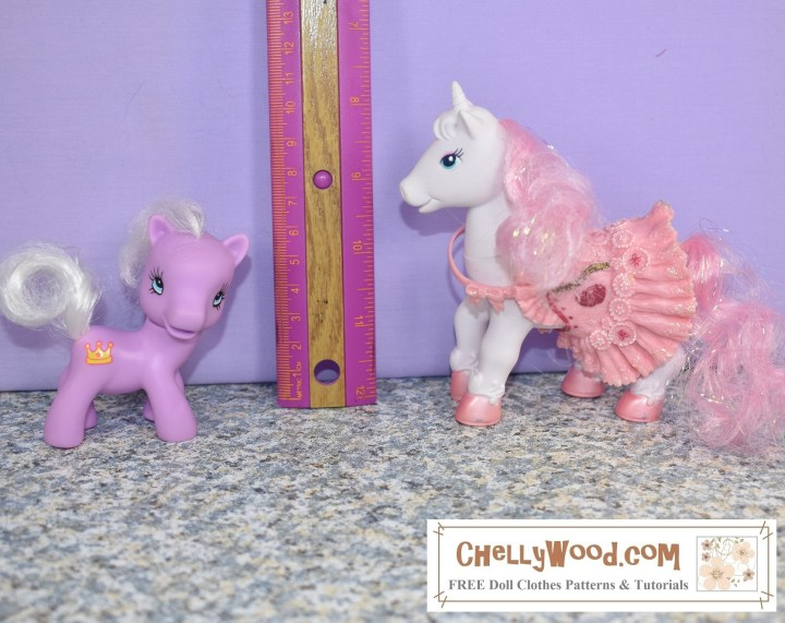 A white plastic unicorn wears a removable plastic saddle that looks sort of like a ballerina's tutu. A small lavender plastic horse stands on the other side of a ruler, to show how tall this little toys are. The white unicorn is about 5 inches tall while the lavender one is less than 4 inches tall.