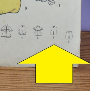 Here we see a close-up of the line drawing for a halter top pattern that closes at the back, and which has a tie at the back of the neck.