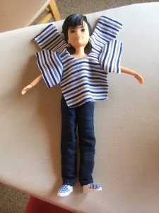 "Today's blog post asks, ""How did you learn about ChellyWood.com?"" And the blog post is accompanied by this image, which Chelly posted on Instagram and Facebook recently. She's doing a poll on her website, to see where most of her followers learn about her website, and this image of a Creatable World doll wearing jeans and a half-finished shirt (Chelly's work-in-progress sewing project) was posted on Chelly's Facebook page recently."