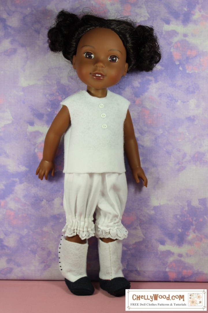 """The image shows a Wellie Wishers 15-inch doll (from American Girl) wearing handmade Victorian underwear, including a pair of lace-trimmed bloomers and a simple sleeveless undershirt. If you'd like to make this set of undergarments for your 15 inch dolls, please click on the link in the caption. The patterns and tutorials for the boots are found in the """"doll shoes"""" section of ChellyWood.com rather than on the page provided by the link in the caption."""