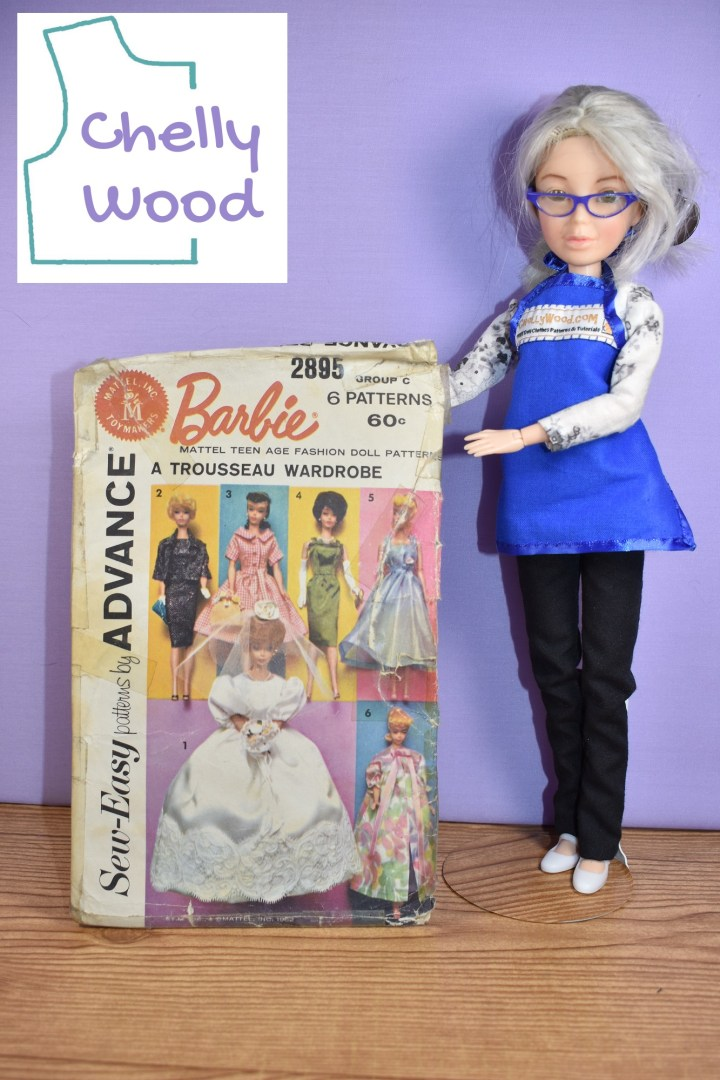 Here we see the Chelly Wood doll (a Spin Master Liv doll that has been re-envisioned) holding up the Sew-Easy Patterns by Advance vintage Mattel, Inc. Toymakers Barbie doll clothes sewing pattern #2895. The topic of today's discussion is about how the bridal veils in Barbie wedding dress patterns are really floppy and hard to keep on the doll's head during play time. In this image, we see that the bridal veil for this particular pattern looks like a silk flower with a circle of tulle attached to it. The watermark on this image reminds us that the article was written by doll clothing designer, Chelly Wood.