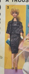 This image shows Sew-Easy Patterns by Advance vintage Mattel, Inc. Toymakers Barbie doll clothes sewing pattern #2895 with a zoom-in on View 2. This doll outfit appears to include a classy black dress with a matching black shrug that has 3/4 inch sleeves, accentuating the tiny white mittens that the vintage Barbie doll with blond bubble cut hair is wearing.