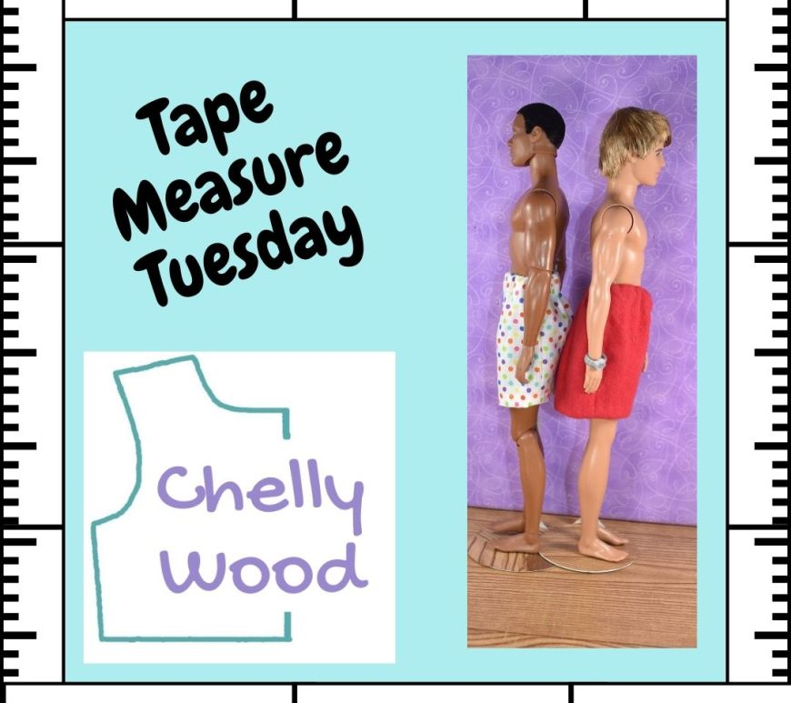 """A light blue square is framed by a white tape measure. Inside the frame, the words """"Tape Measure Tuesday"""" are angled above the Chelly Wood dot com website logo. To the right of these, we see an articulated African American Texas A and M Ken doll back to back with a regular Ken doll with blond hair. Both Ken dolls wear handmade shorts with elastic waists."""