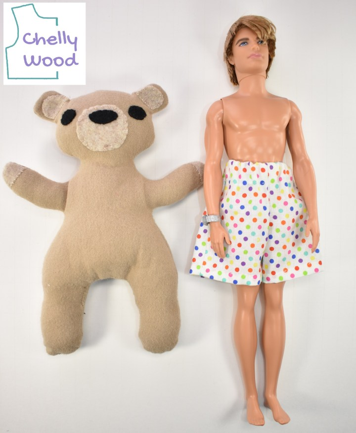 Here we see a modern Ken doll in a pair of polka dot undershorts lying on a white table next to a plush bear. Their body types are quite different. For one thing, Ken's body tapers from broad shoulders to a narrow waist; the bear's body is more of a triangle shape with a narrow upper body and wide hips. Ken's arms are long while the bear's arms are short. Ken stands much taller than the bear -- perhaps by as much as three or four inches (7 to 10 centimeters). And the bear's neck is much, much wider than Ken's neck.
