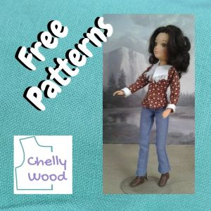 """This is a turquoise blue linen square of fabric with the words """"free patterns"""" laid across it at an angle. Below these words is the Chelly Wood dot com logo. Beside the words is a photo of a World of Love doll (a vintage 8 inch doll made by Hasbro) wearing a brown shirt with tiny white cuffs and a white yoke edged in white fringe over a pair of slightly boot cut jeans."""