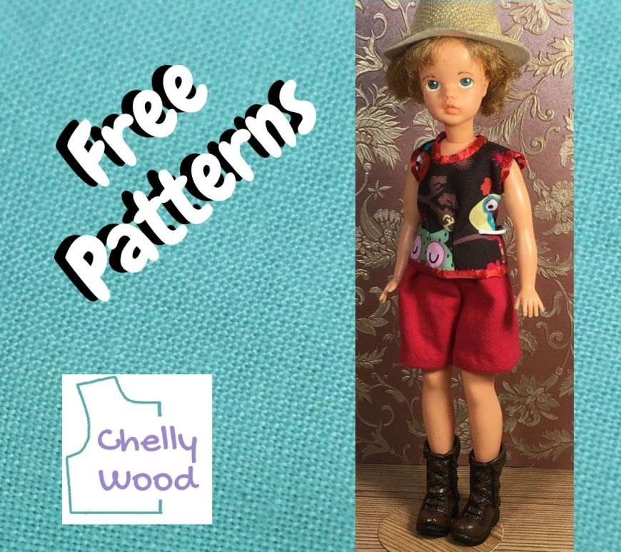 """In the photo, we see a fashion doll wearing safari style doll clothes, including a summer shirt, a pair of shorts, hiking boots, and a safari straw hat. The logo tells us to visit ChellyWood.com for the free printable PDF sewing patterns for making this outfit, and there's text above the logo that says, """"free patterns."""" The entire images is on a square frame of turquoise blue linen fabric."""