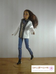 """Visit ChellyWood.com for free, printable sewing patterns for dolls of many shapes and sizes. Images shows Mattel's """"Teresa"""" doll running across a wooden floor, wearing a two-toned (charcoal grey and creamy-white) jacket with a zipper that goes up to a collar. She also wears a plain pair of jeans. Patterns for both the zipper jacket and the jeans are free and easy to download and print at Chelly Wood dot com."""