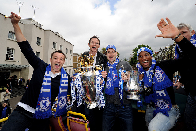 LONDON, ENGLAND - MAY 16:  John Terry (L), Frank Lampard, Petr Cech and Didier Drogba (R) of Chelsea pose with the Premier League and FA Cup trophies during the Chelsea Football Club Victory Parade on May 16, 2010 in London, England.  (Photo by Darren Walsh/Chelsea FC via Getty Images)