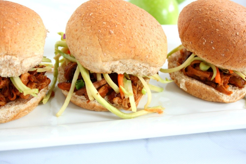 Fall is almost here! The weather is cooling down, football has kicked off, and pumpkins are everywhere. Dust off that slow cooker and try my slow cooker apple pork sliders recipe. This delicious dish is perfect for all of those Fall festivities.