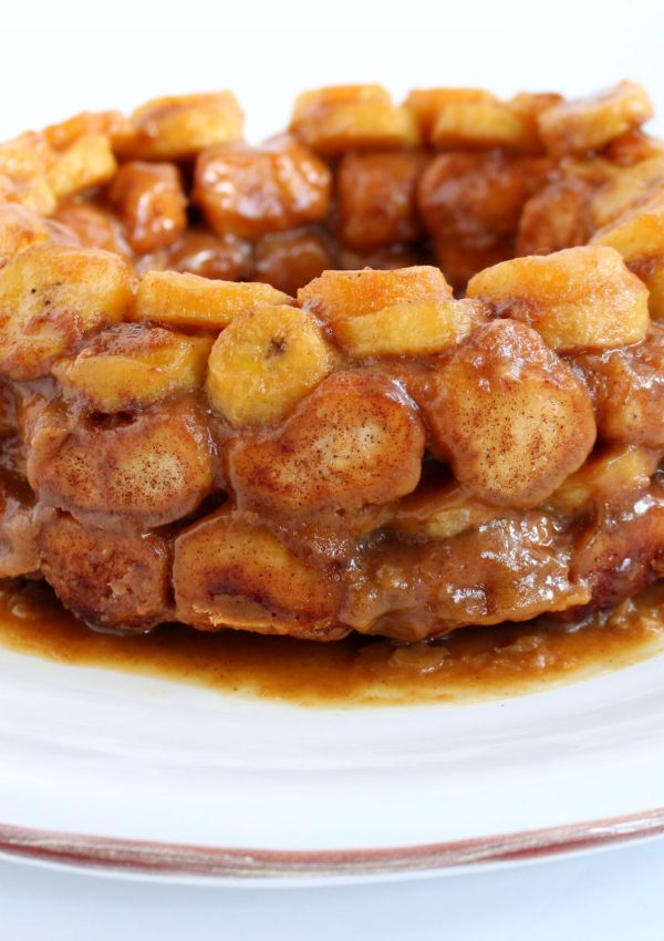 Sweet, ooey gooey, monkey bread gets a Cajun twist with my lightened-up Banana's Foster Monkey Bread. This decadent treat is complete with a bourbon caramel sauce that will have you thinking you're in the French Quarter!