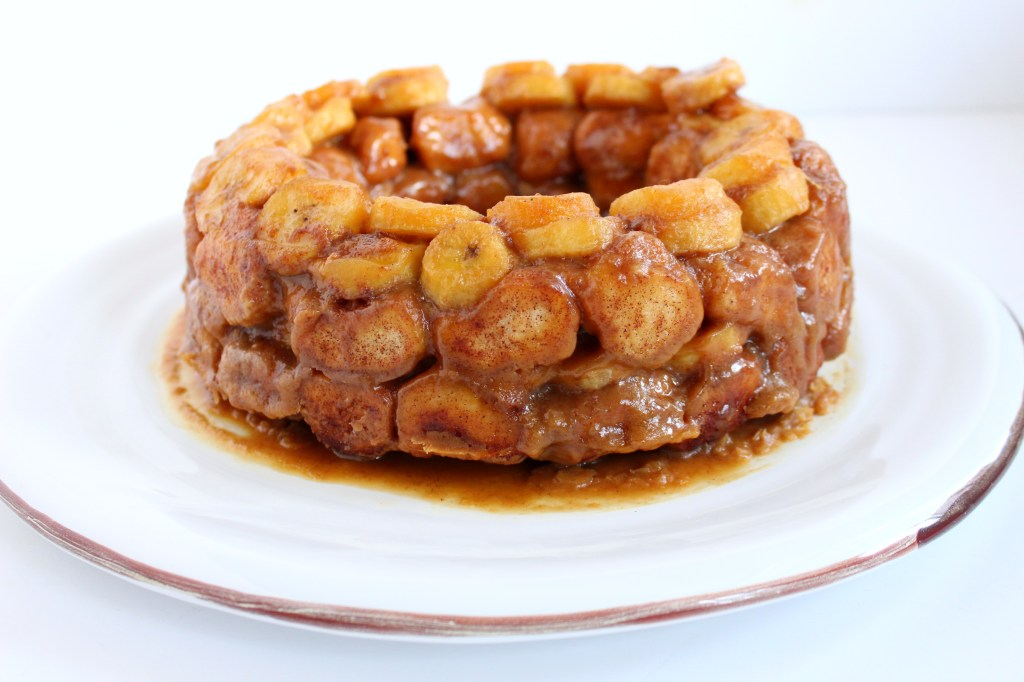 Sweet, ooey gooey, monkey bread gets a Cajun twist with my lightened-up Bananas Foster Monkey Bread. This decadent treat is complete with a bourbon caramel sauce that will have you thinking you're in the French Quarter!