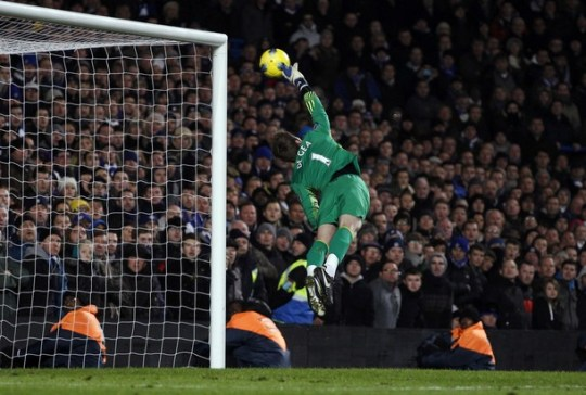 Manchester United's goalkeeper David de Gea makes a save during their English Premier League soccer match against Chelsea at Stamford Bridge in London