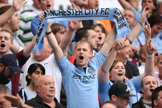A+Manchester+City+fan+shows+his+support+in+the+stands+during+the+FA+Community+Shield+at+Villa+Park