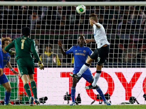 Guerrero of Brazil's Corinthians heads the ball to score during their FIFA Club World Cup final soccer match against Britain's Chelsea in Yokohama