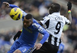 Newcastle United's Cisse challenges Chelsea's Cole during their English Premier League soccer match in Newcastle