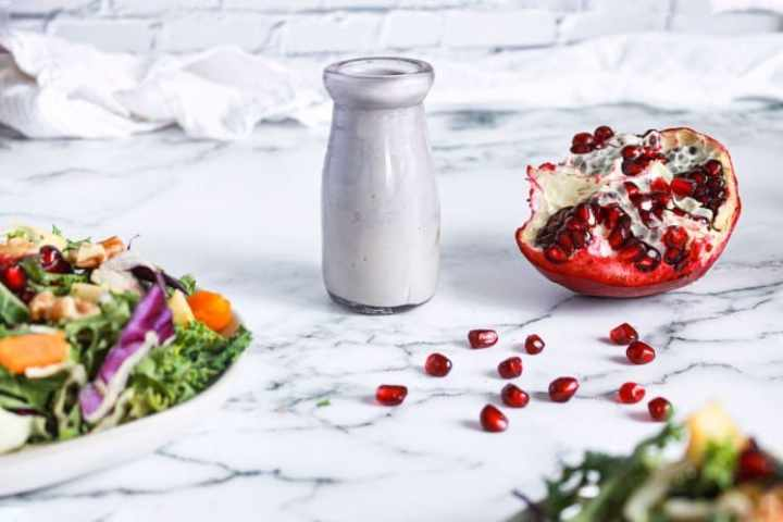 Dressing carton with Pomegranate Tahini Dressing