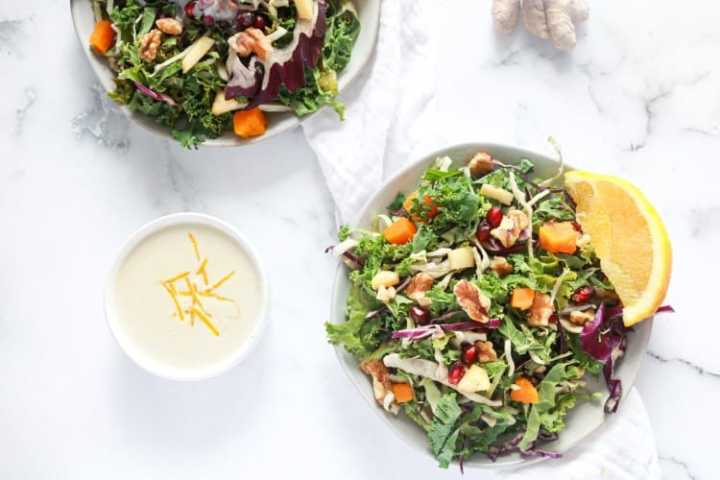 Salad in two plates with Orange Ginger Tahini Dressing