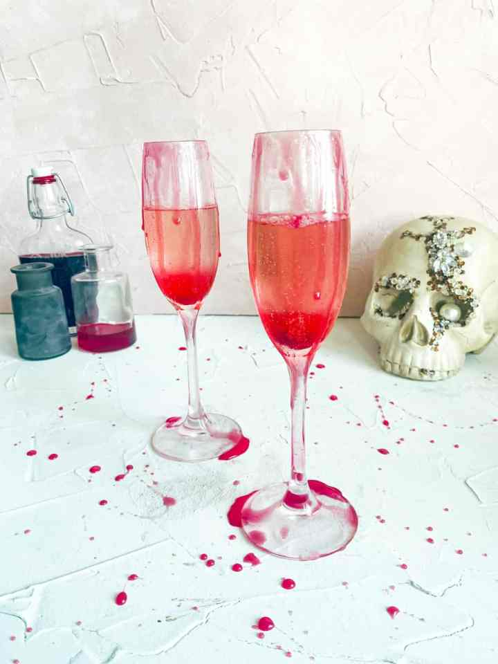 Bloody Mimosa in two glassed with blood dripping around them