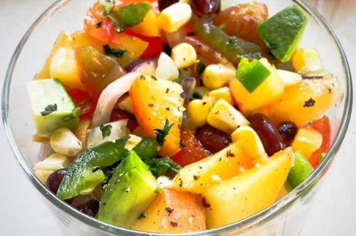 of jalapeno and peach salsa with black beans and jalapenos in a glass.