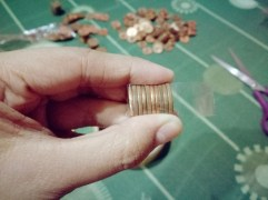 Wrap the coins, you can add up more coins as long as it is still handy and easy to wrap.