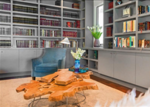 If yours is a built-in bookshelf, you can match the colour of the bookshelf with the wall colour.