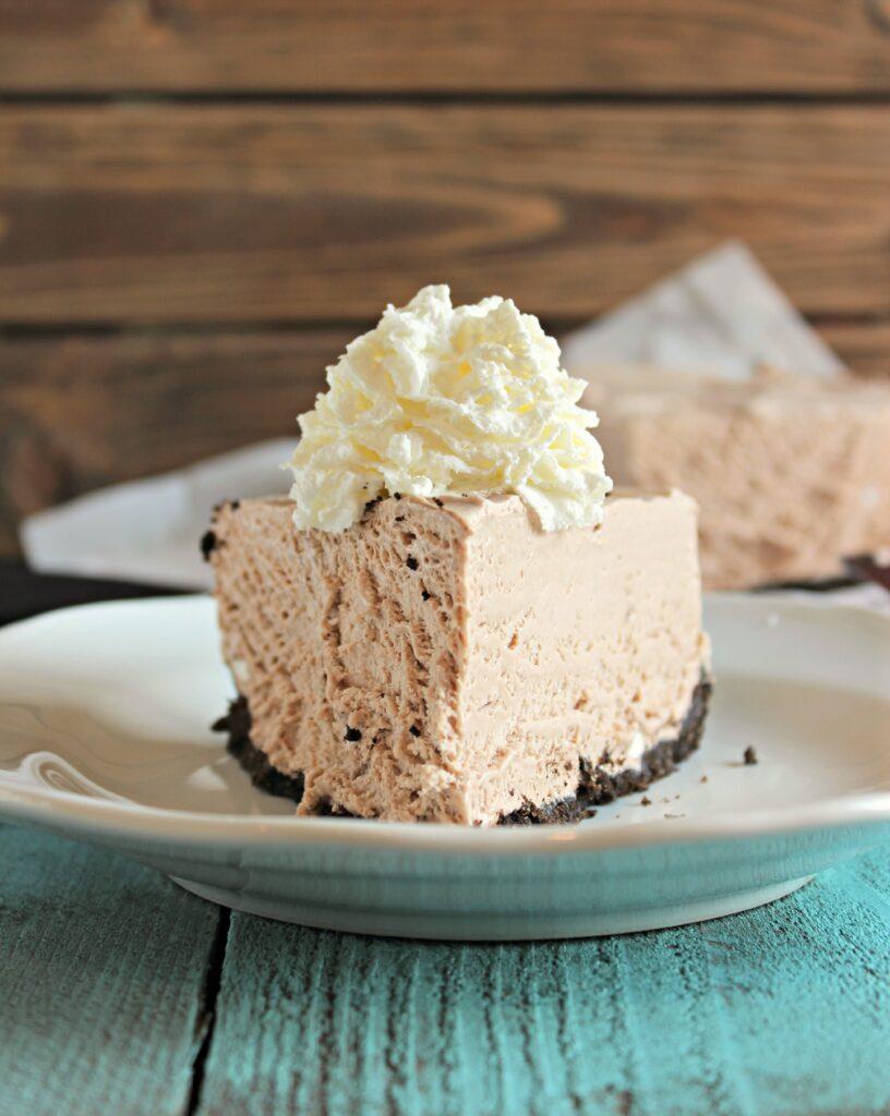 "Frozen Hot Chocolate Cheesecake Dessert Recipe | Chelsea's Messy Apron ""A frozen hot chocolate ice-cream pie with an oreo crust, mini marshmallows, and swirls of marshmallows mixed throughout."""