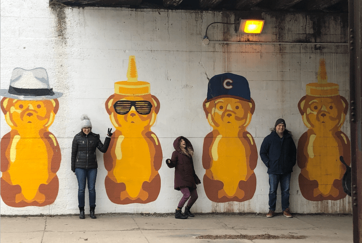 Clients from Focused Labs with the Honey Bear Mural