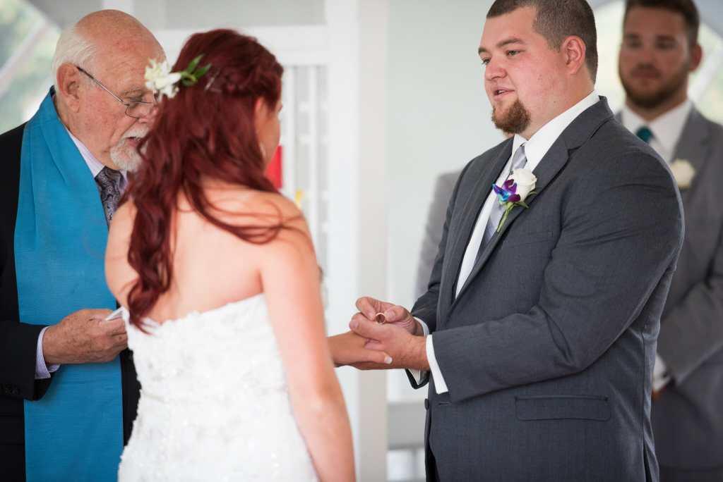couple exchanging wedding rings hamilton
