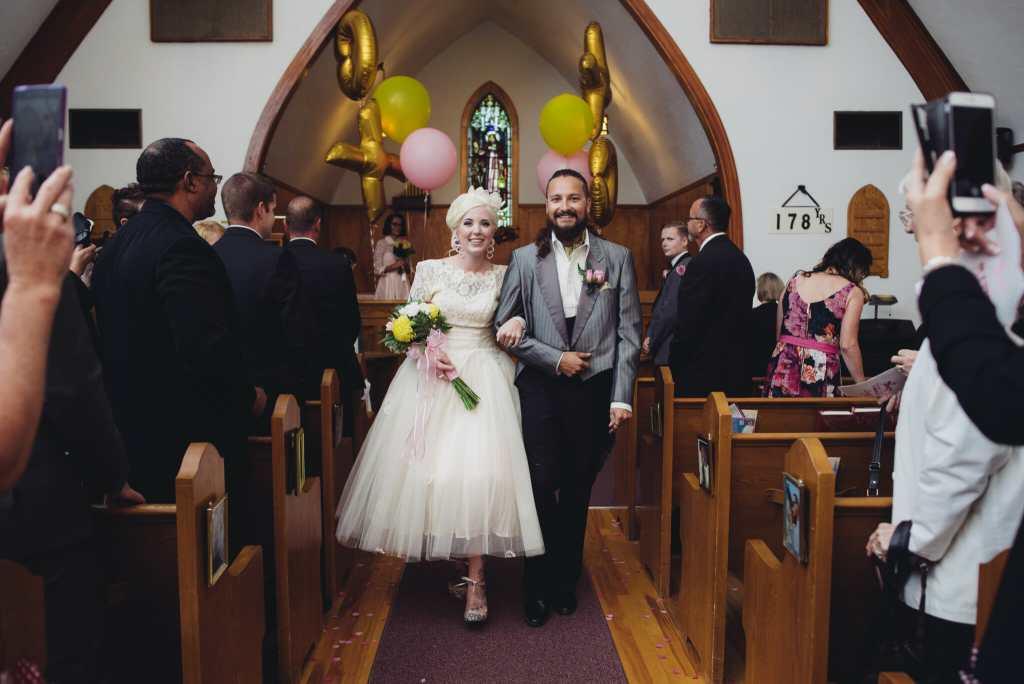 newlyweds walking down the aisle at kedron united church
