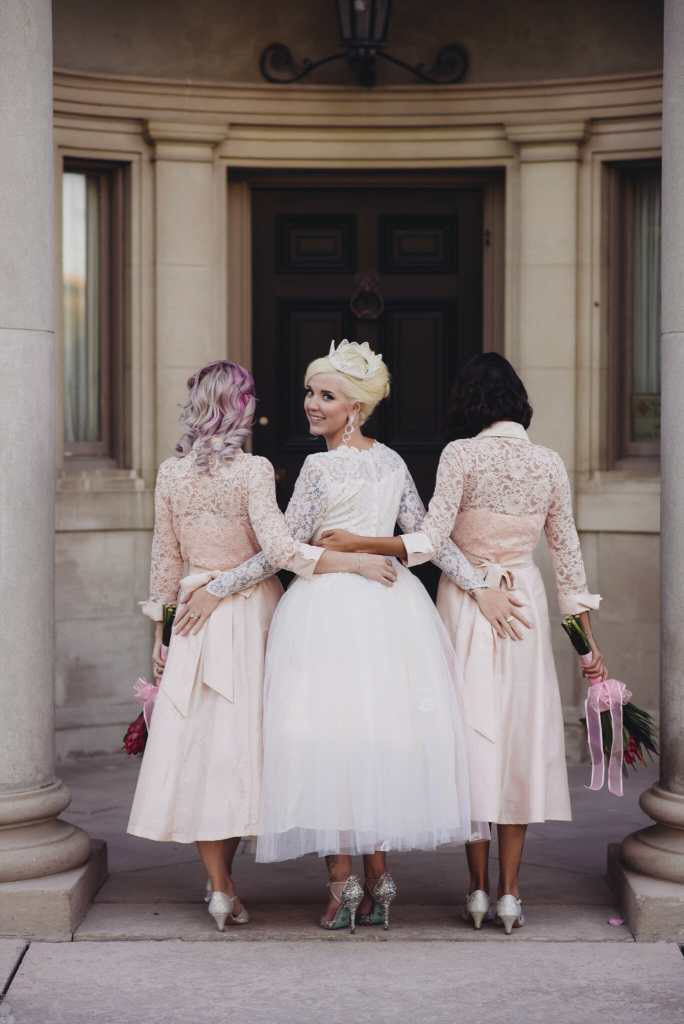bride and bridesmaids in front of parkwood estate