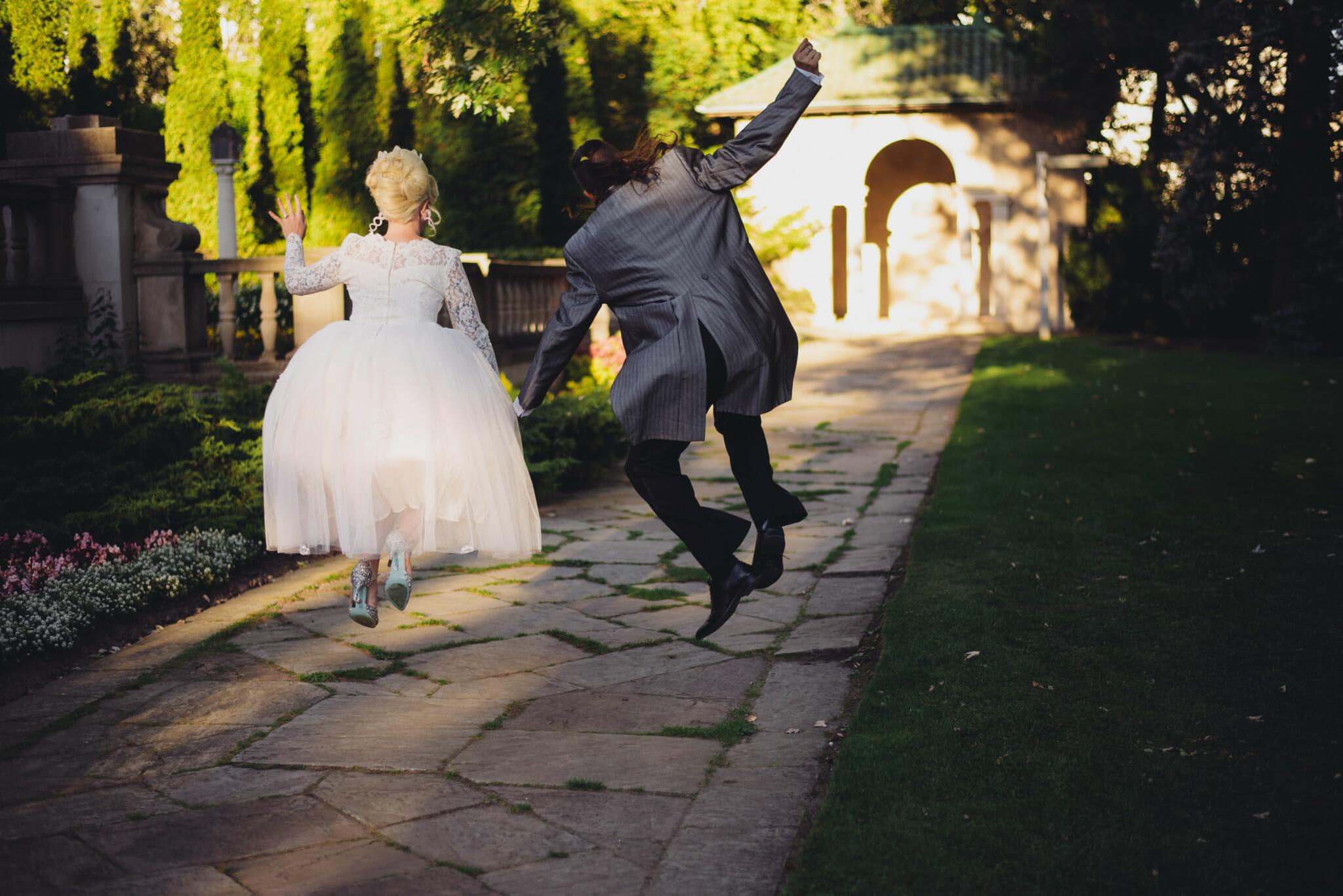 newlyweds jump for joy on parkwood property