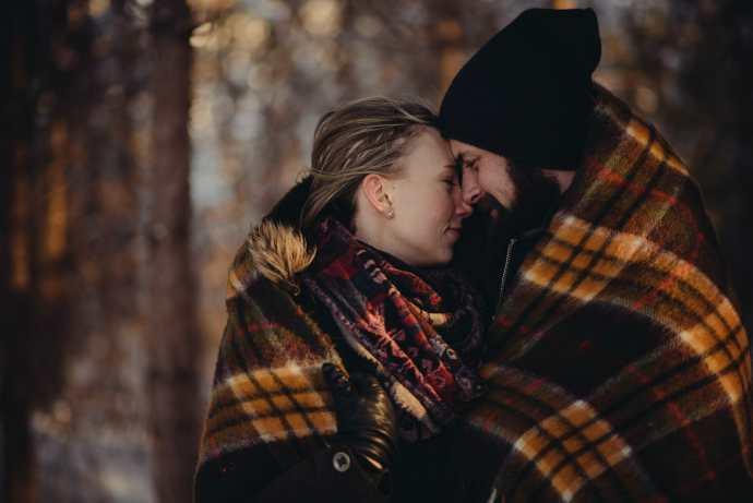 fiancees warm up under blanket