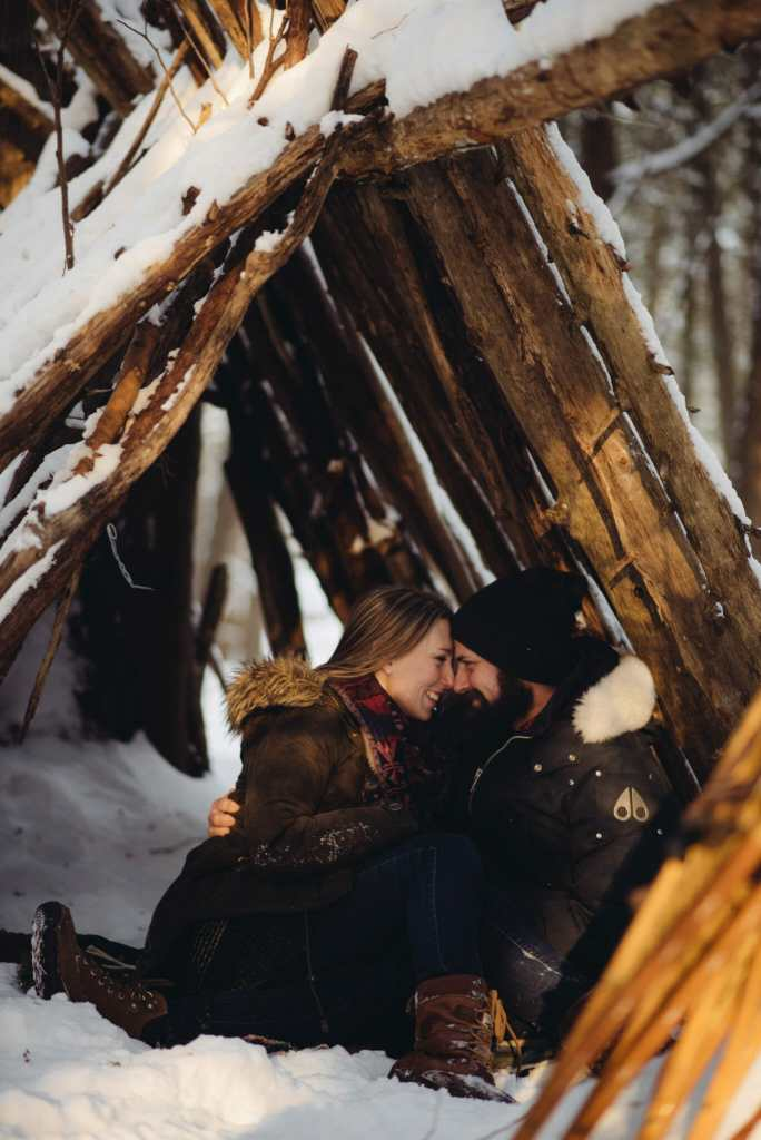 couple in lean to in the winter