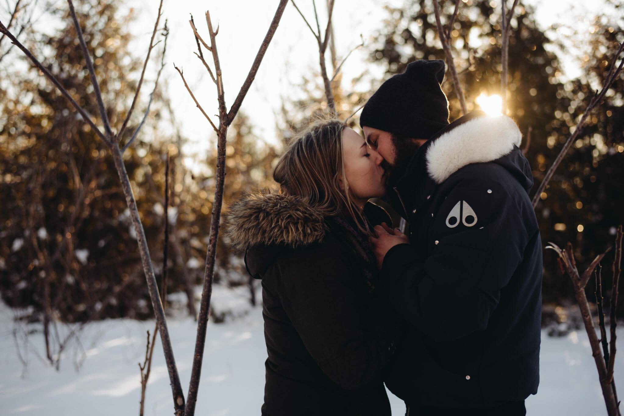 couple kisses in engagement photos ajax