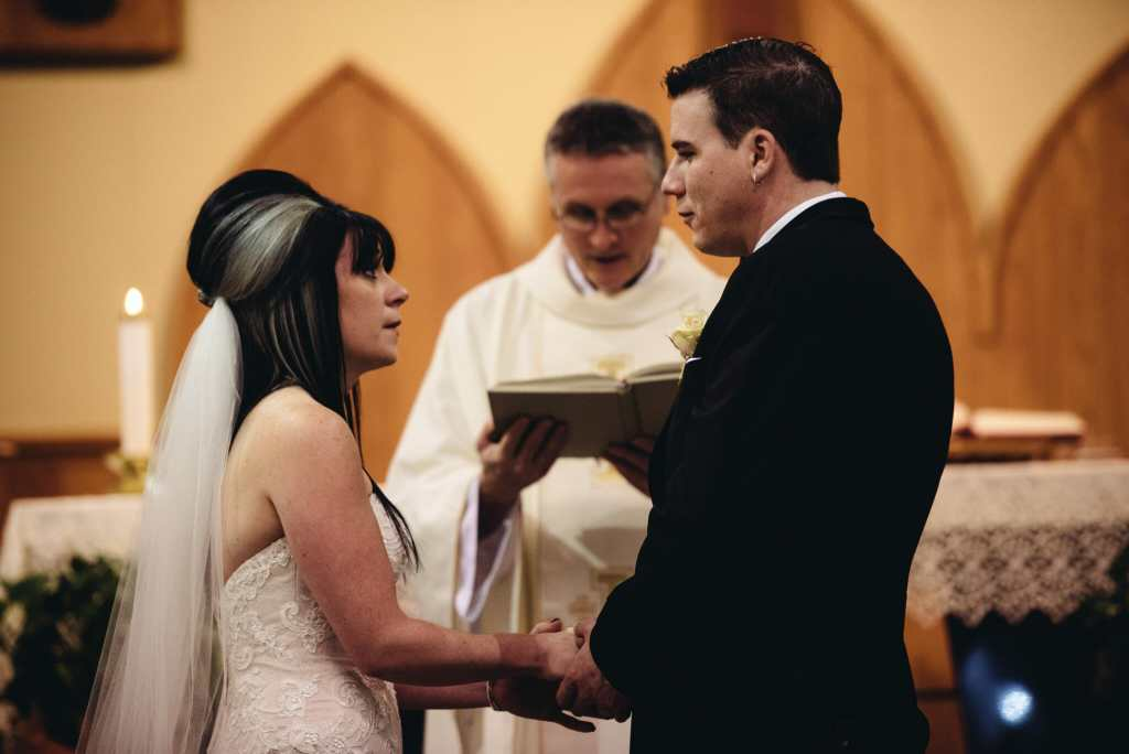 couple says vows at st Joseph's church wedding bowmanville
