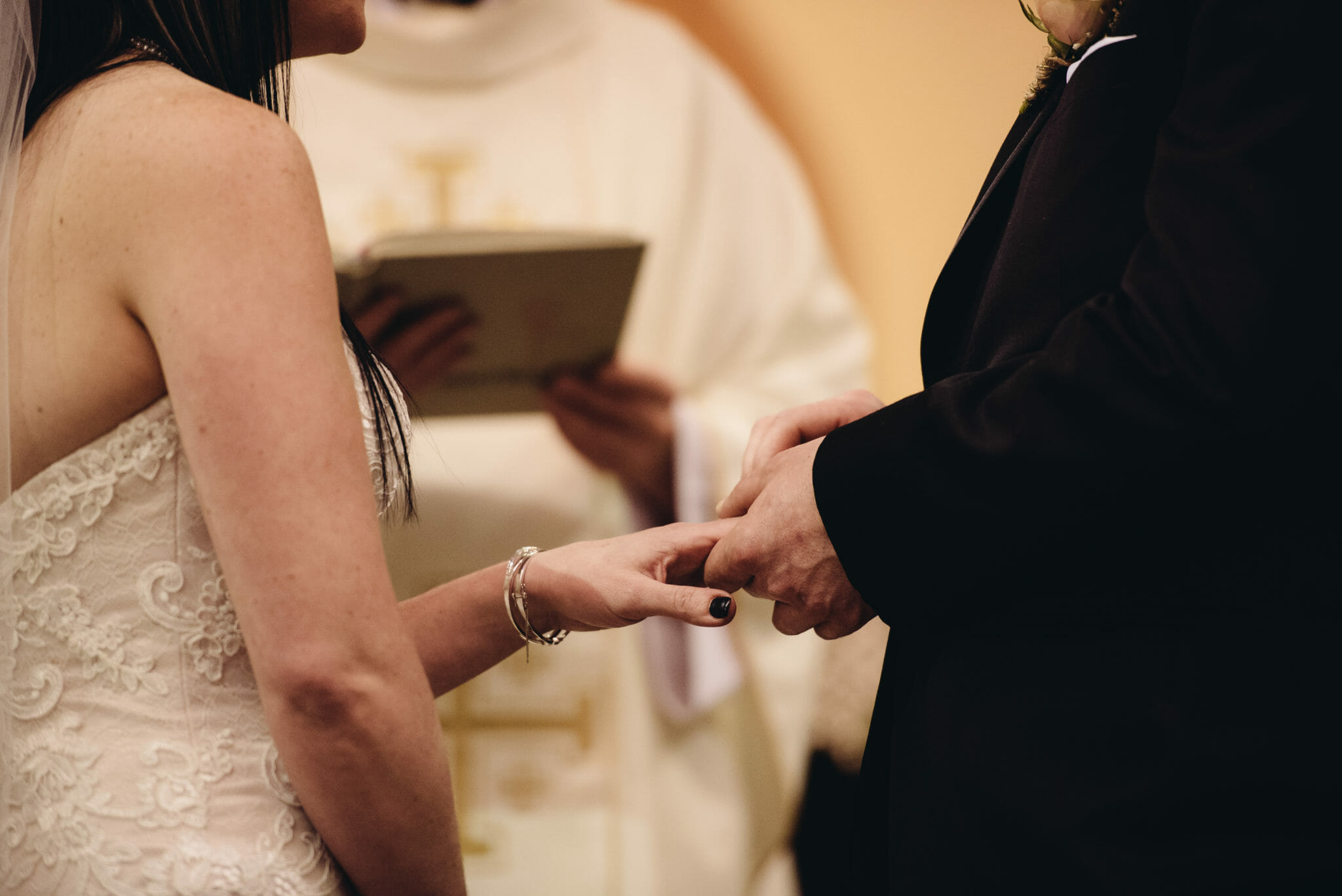 exchanging rings at church wedding bowmanville