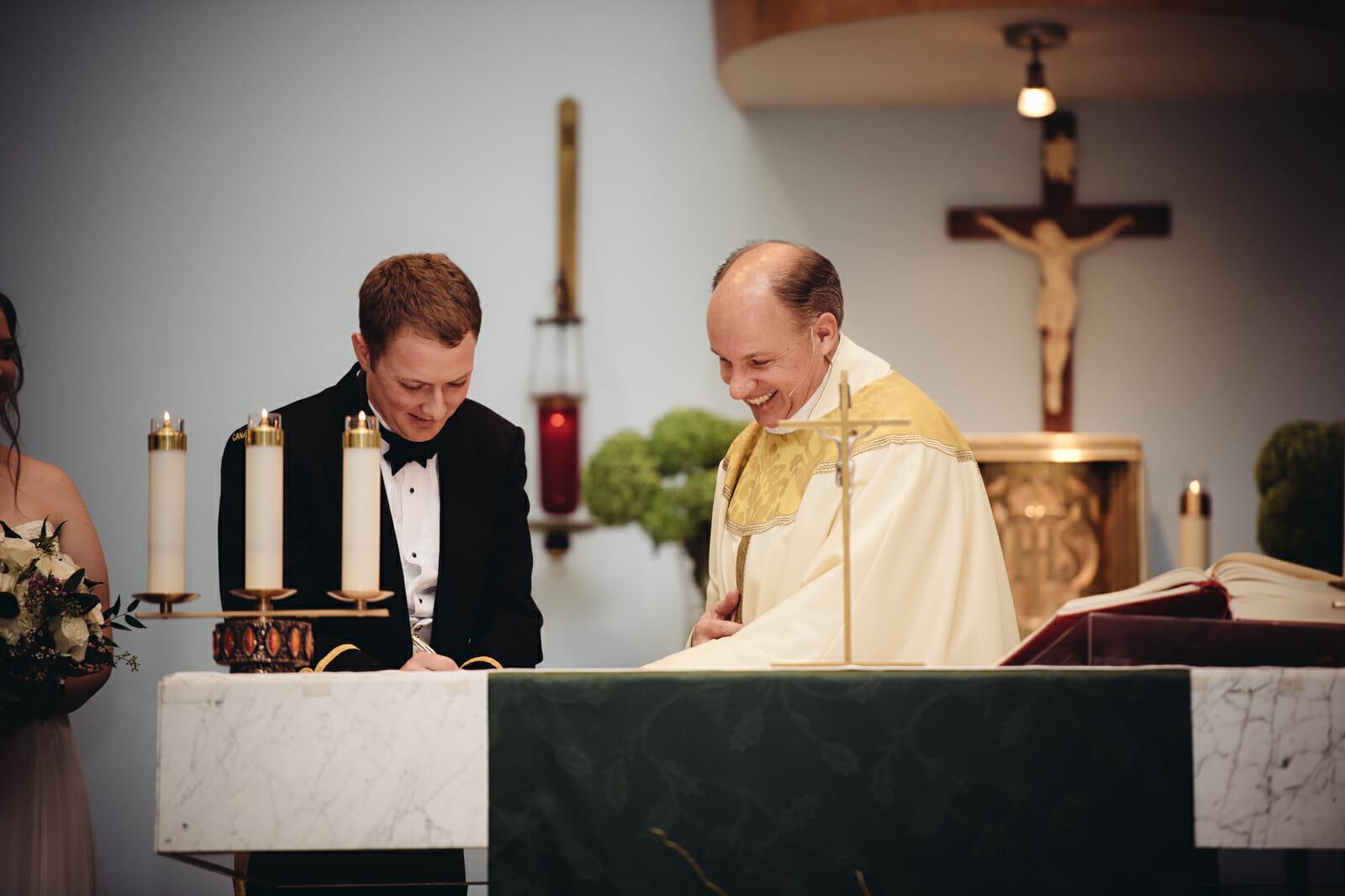 groom signs marriage certificate brooklin ontario wedding