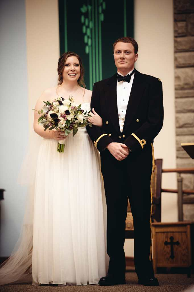 newlyweds at st leo church wedding brooklin