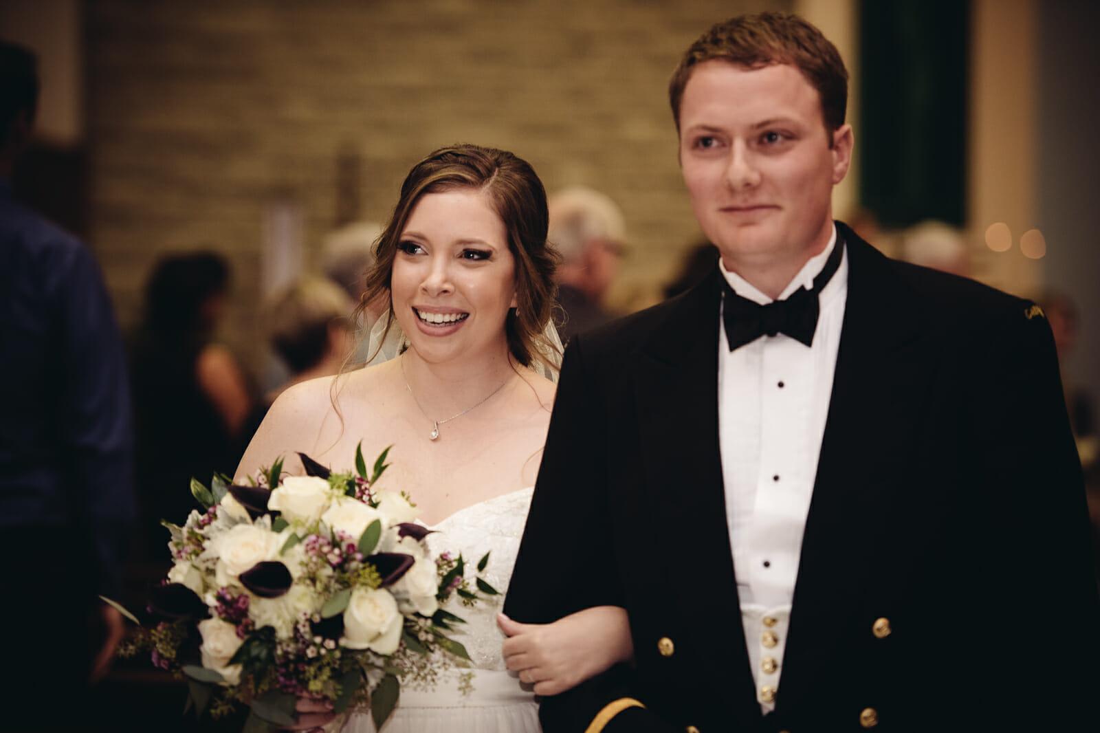 couple walks down the aisle as newlyweds