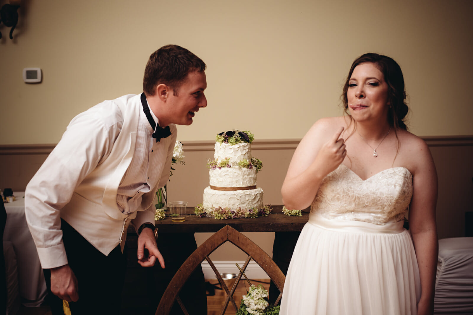 cake cutting photo by whitby wedding photographer