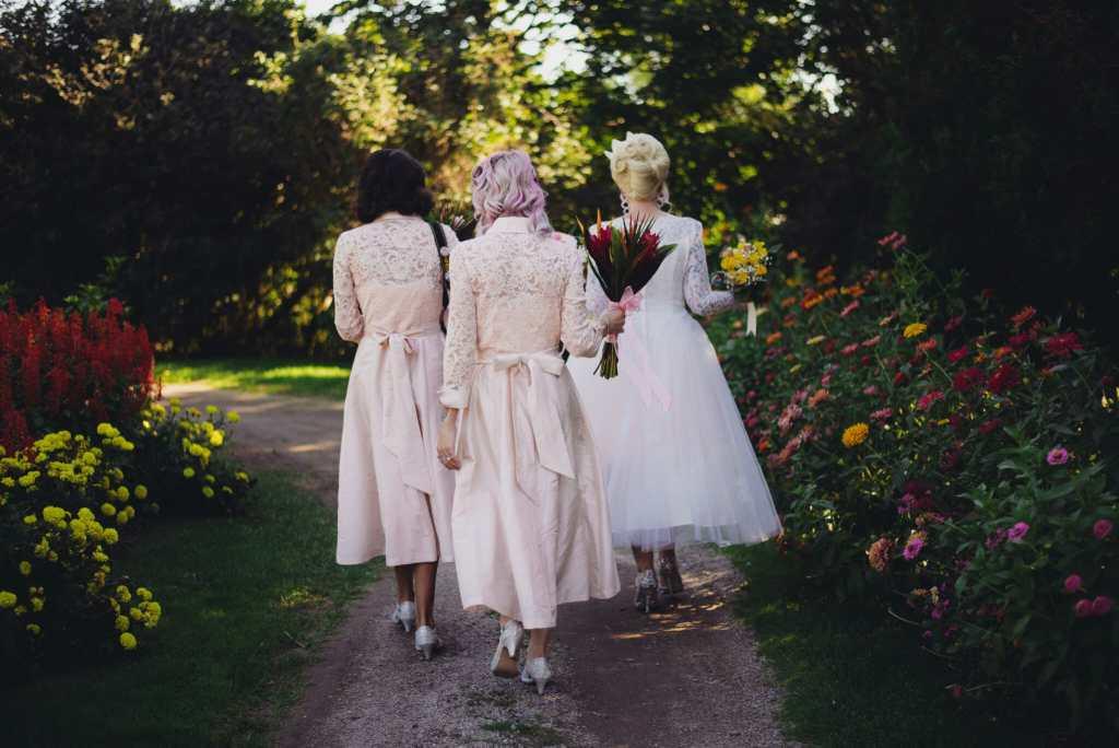 bride and bridesmaid walking in parkwood estate gardens