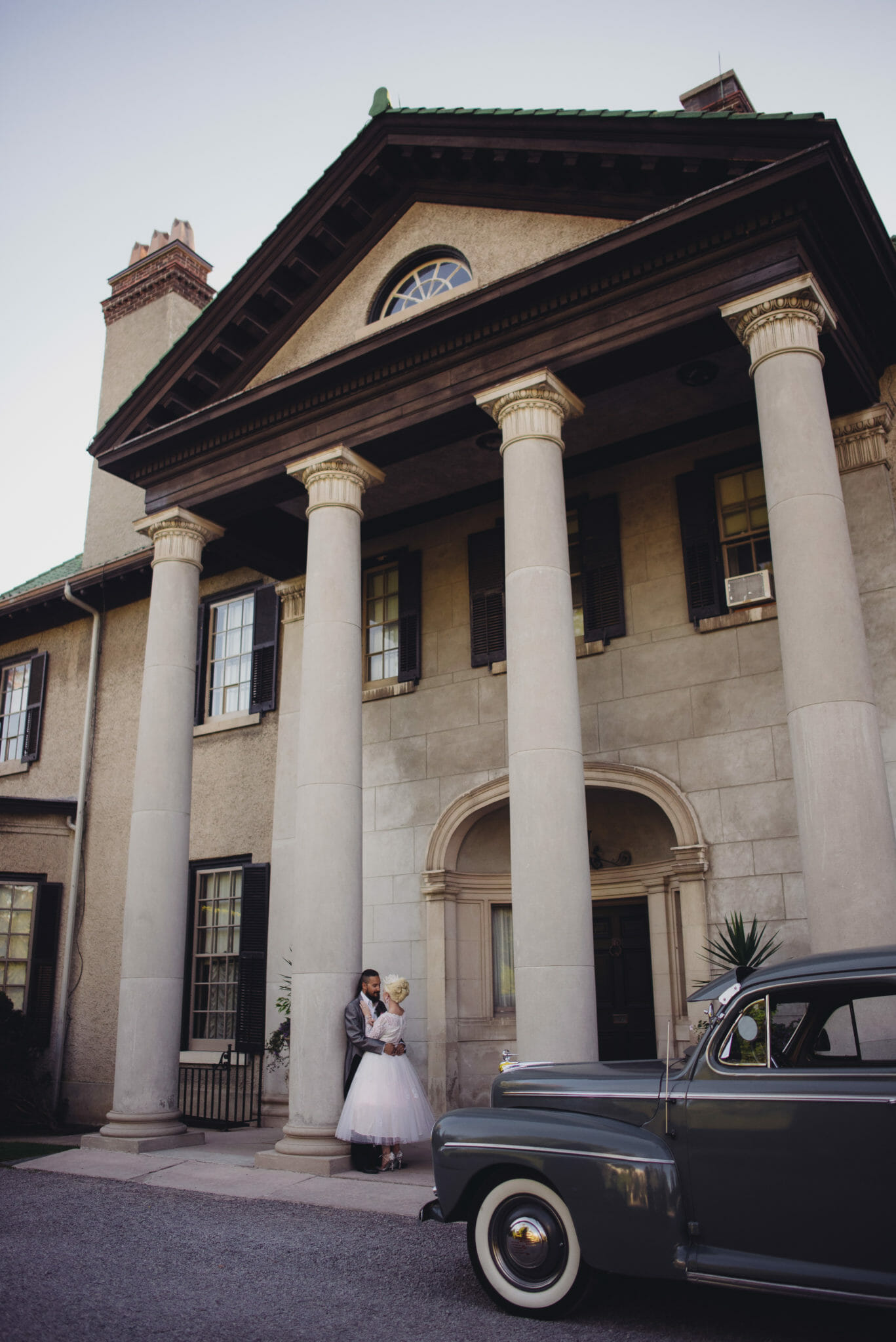 married couple in front of parkwood house oshawa