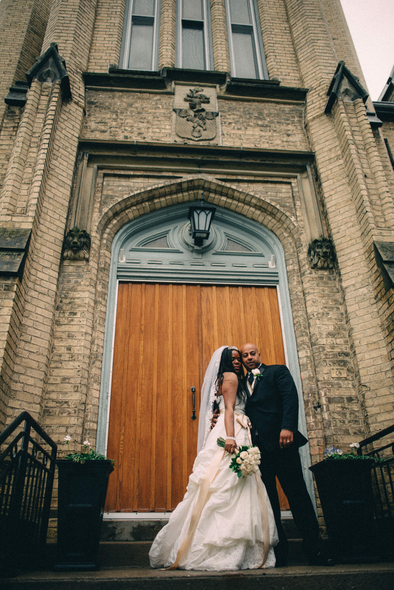 bride and groom in front of trafalgar castle school